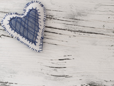 textile heart on the wooden background