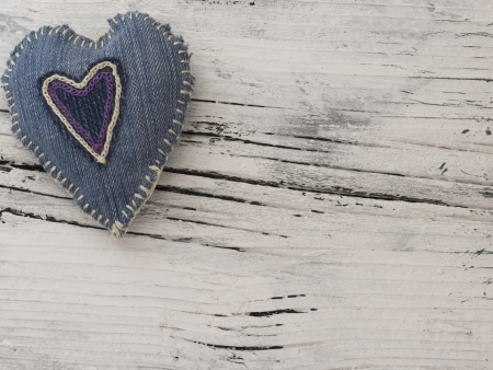 textile heart on the wooden background photo