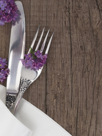grunge flatware: utensils on the wooden background with place for the text
