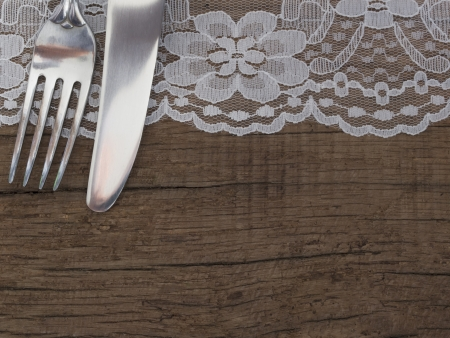 antique dishes: utensils on the wooden background with place for the text