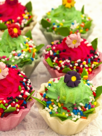 unhealthy eating: colorful and tasteful cupcakes