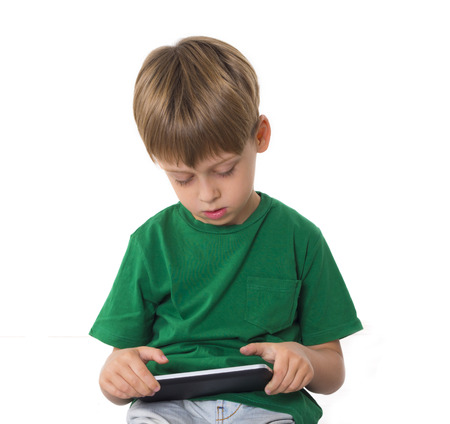 boy playing video games on the tablet computer photo