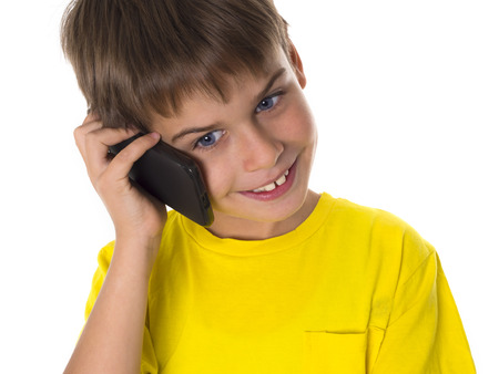 smiling boy with mobile phone Stock Photo - 22524458
