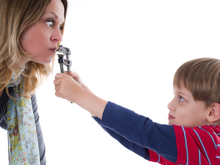 wicked problem: Naughty child does not allow his nervous mother to talk - young rebel