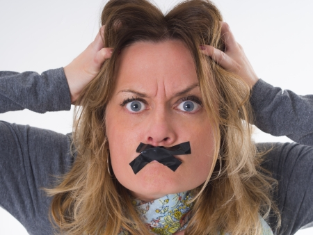 preassure: furious woman with sticky tape on her lips, shut up, do not spreed negative emotions