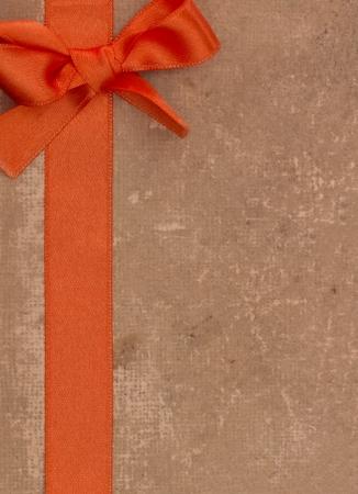 grundge: orange bow on the grundge background