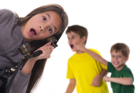 shocked girl reporting a fight between boys Stock Photo - 23932213