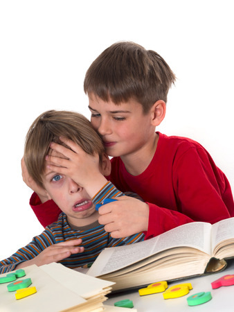 helps: a boy calms his younger brother