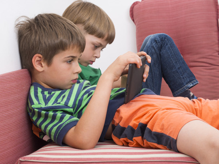 boys playing video games on the tablet computers  photo