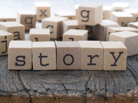 Story word made of wooden cubes
