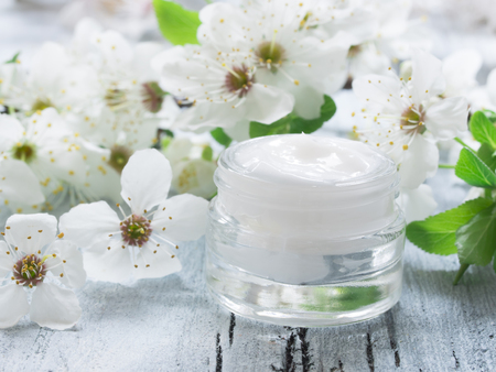 beauty background: natural facial cream, fresh as flowers Stock Photo