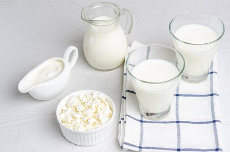 Homemade fermented milk products - kefir, cottage cheese on a white background, copy space, flat lay. Ferment for yeast bacterial fermentation, intestinal health concept.