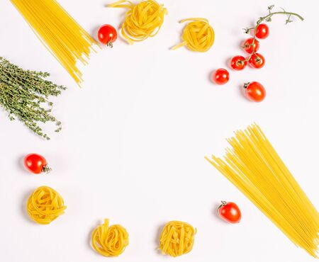 Raw tagliatelle pasta, spaghetti with tomatoes, thyme on a light background, round frame with copy space for text, flat lay. Proper nutrition, diet. View from above