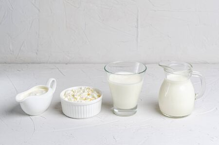 Homemade fermented beverage in a glass of kefir, cottage cheese, sour cream on a white background. Sour milk drink, sourdough for yeast bacterial fermentation, intestinal health concept. 版權商用圖片