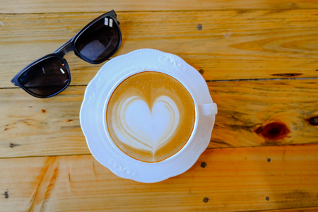 capucinno: coffee latte art on wood table Stock Photo