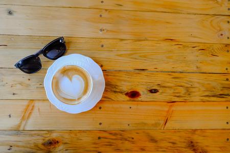 kafe: coffee latte art on wood table Stock Photo
