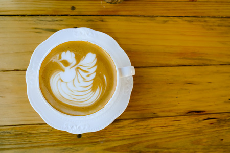 cappaccino: coffee latte art on wood table Stock Photo