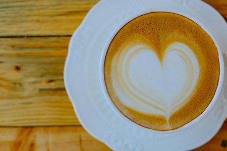 capucinno: coffee latte art on wood table Stock Photo