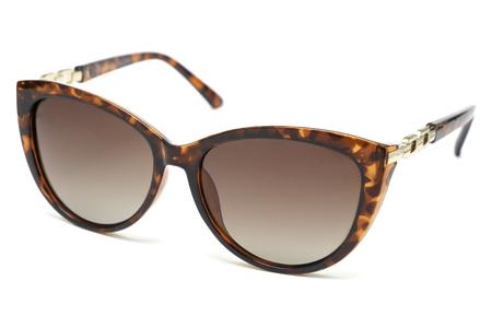 Stylish modern fashionable female sunglasses close up on a white background Stock Photo