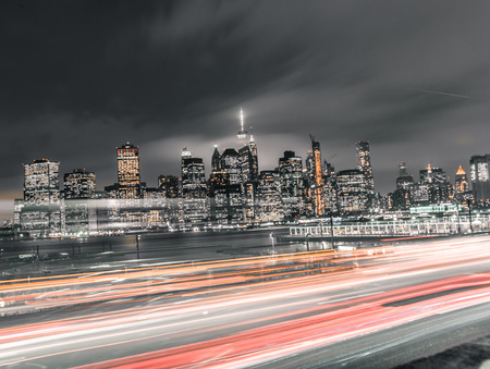 long exposure photograph of downtown manhattan with rush hour traffic 写真素材