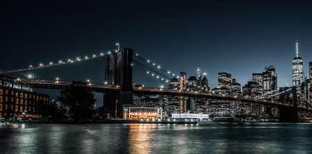 Brooklyn Bridge long exposure during evening rush hour Stock Photo