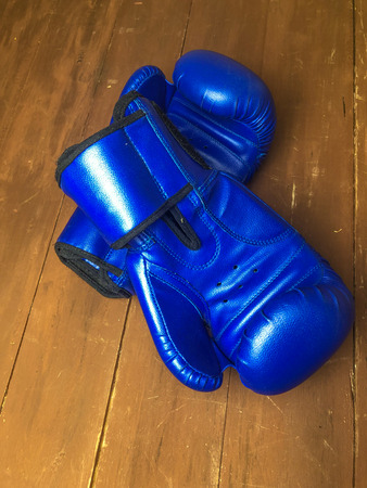 Boxing gloves on wooden background.flat Ley style 写真素材