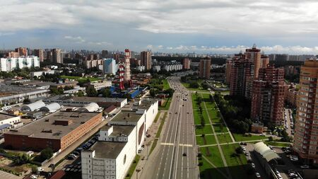 Aerial view of road and buildings near. Big town footage fly drone. Stockfoto