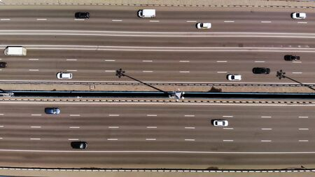 Top down aerial view on 11 lanes bridge with lot of cars and buses. moving right Stockfoto
