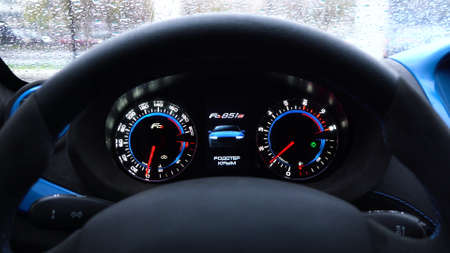 Moscow, Russia - 10 12 2019: Several footages of car dashboard of new russian sport car roadster Crimea. Starting engine. Signs: Roadster Crimea, mileage per trip, not initialized