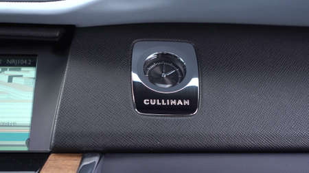 Moscow, Russia - 13 03 2020: Interior Rolls Royce Cullinan. Mechanical watches that are located on the dashboard of a car.