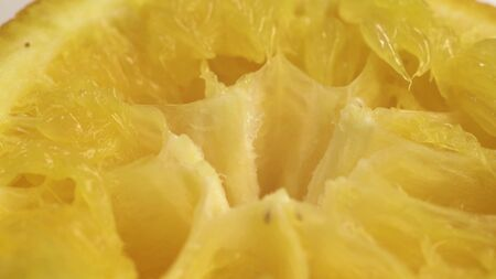 close up footage of squeezed orange. We drank the juice from the fruit and left only the cake from citrus Stockfoto