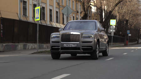 Moscow, Russia - 13 03 2020: Great footage of expensive Rolls Royce Cullinan who rides on the road and blinks turn signals