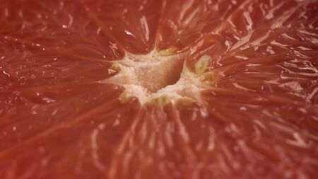 Close up macro shot of grapefruit, which is crushed or squeezed. Fruit Juice Covers Go Out and cover citrus