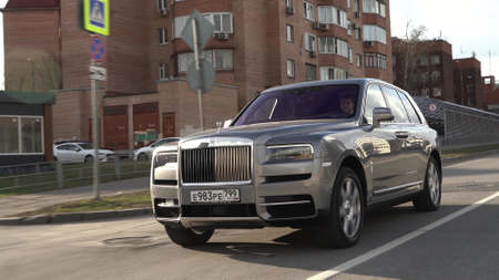 Moscow, Russia - 13 03 2020: Rolls Royce Cullinan hit the road. Driving expensive car on the streets of Moscow.