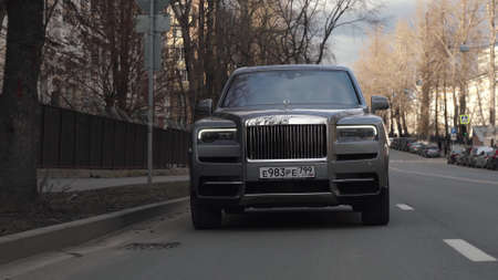 Moscow, Russia - 13 03 2020: Rolls Royce Cullinan hit the road. Driving expensive car on the streets of Moscow Redactioneel