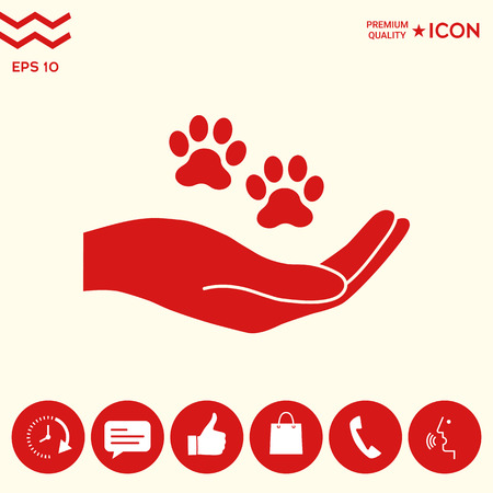 Hand holding paw symbol. Animal protection