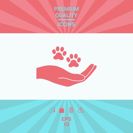 Hand, die Pfotensymbol hält. Tierschutz