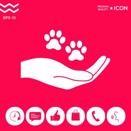 Hand holding paw symbol. Animal protection