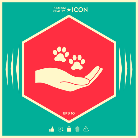 Hand hält Pfote Symbol . Tierschutz