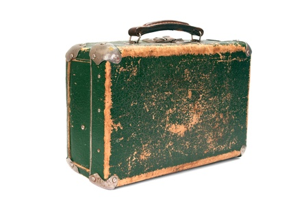 Old green shabby suitcase on white background photo