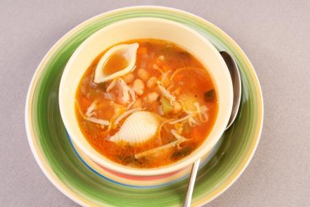 Bowl of minestrone soup, sprinkled with parmesan cheese Stock Photo - 24040475