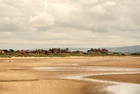 View of the town of Troon in Scotland. Low tide photo