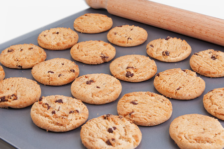 chip and pin: Chocolate chip cookies  on a baking tray with a rolling pin