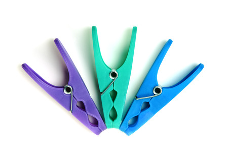 clothepeg: Three plastic clothes pegs on a white background