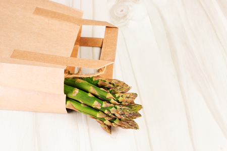 Fresh green asparagus in a shopping paper bag. Selective focus 写真素材