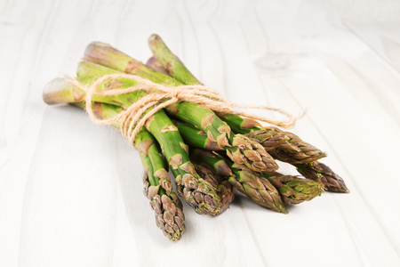 Fresh green asparagus on a white wooden table 写真素材