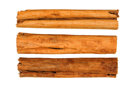 Cinnamon sticks isolated on white background. View from above 写真素材