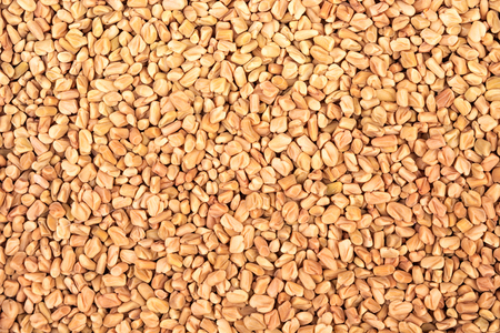 Fenugreek seeds background. View from above