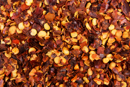 Chilli pepper flakes background. View from above
