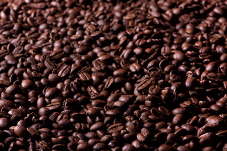 Background of roasted coffee beans. Selective focus